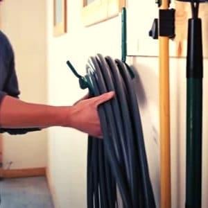 store garden hose by using a hanger