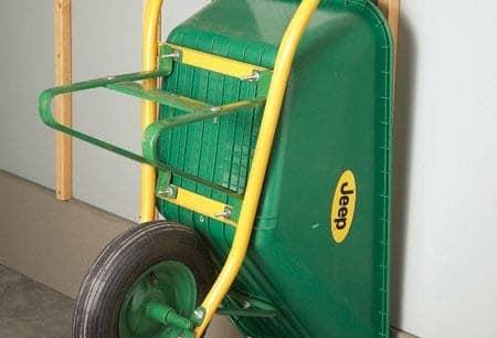 Using Plumbing Hook to store Wheelbarrow